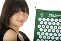 Heavenly acupressure mat, model holding mat.