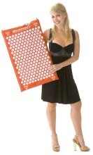 Lady holding an orange acupressure mat